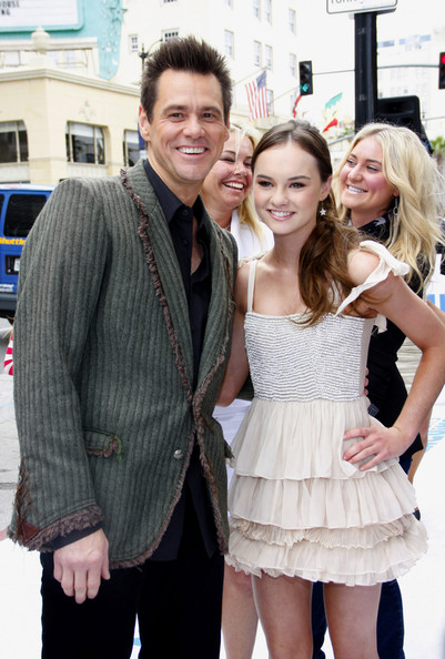 "Jim Carrey and Madeline Carroll at the Los Angeles premiere of ""Mr. Popper's Penguins"" held at the Grauman's Chinese Theatre, Los Angeles."