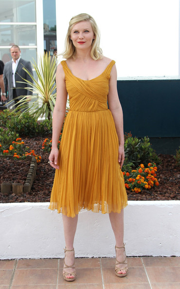 Kirsten Dunst in a mustard colored dress at the  'Melancholia' photocall at the 64th Cannes Film Festiva.