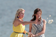 """Cast members of TV show """"Cougar Town"""" Busy Philipps and Christa Miller film scenes as Josh Hopkins asks Courtney Cox to marry him on Long Beach."""