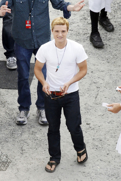 Josh Hutcherson Josh Hutcherson shows up to the set of Catching fire with his dog and his entourage in Atlanta, Georgia, on Thursday, September 13, 2012. When leaving for the day he was seen carrying a large box of Dermalogica. .