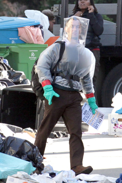 "Jude Law walks around with a protective suit and headgear while filming a scene for his upcoming film ""Contagion"", on a sunny day in San Francisco. The actor, who recently split yet again from girlfriend Sienna Miller, passed out pamphlets whilst wearing a transparent, plastic box on his head."