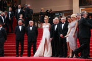 "The Jury at Cannes arrive at the premiere screening of ""Midnight in Paris"" on the opening night of the  64th Annual Cannes Film Festival.  Jury members including Johnnie To, Uma Thurman, Jude Law, Linn Ullmann, Linn Ullmann, Martina Gusman, Olivier Assayas, Nansun Shi and Mahamat-Saleh Haroun pose with Frederic Mitterand on the red carpet."