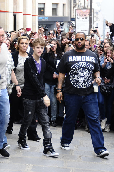 "Justin Bieber Teen heart-throb Justin Bieber leaving his Paris hotel amidst a flurry of female fans wearing a 'Stewie' pendant from the US cartoon ""Family Guy"". Bieber was leaving France to head onto Belgium for his next tour date in Antwerp."