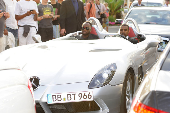 Kanye West Kanye West, wearing a tuxedo, is spotted driving a Mercedes concept car to an event during the 64th Annual Cannes Film Festival.