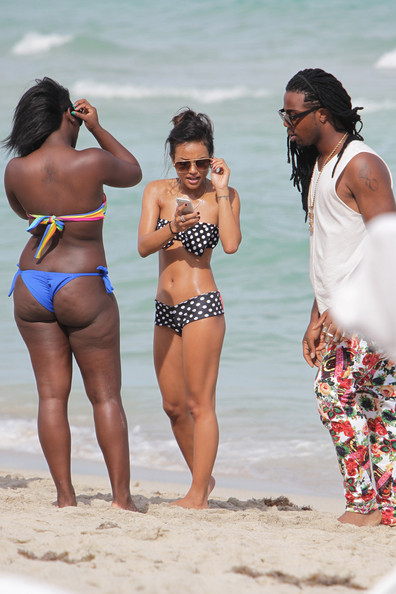 Karrueche Tran heats up Miami beach in a polka dot bow bikini.