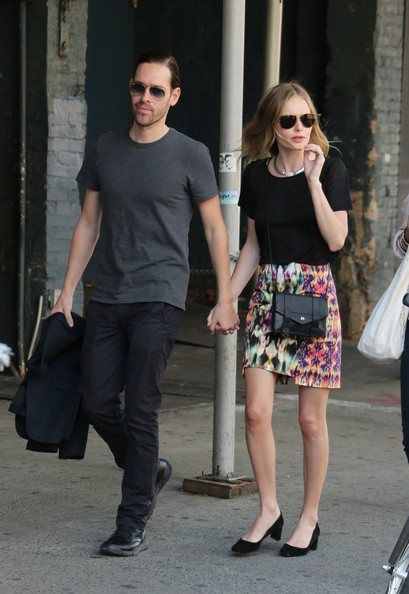 are seen shopping at theory clothing store as they stroll around the