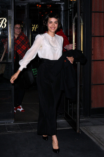 Shannyn Sossamon Shannyn Sossamon, American actress, leaves the Bowery Hotel wearing a white blouse and black trousers.