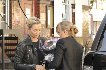 Katie Young Kate Moss and her personal assistant Katie Young drop a bouquet of flowers at a friends house in King's Cross