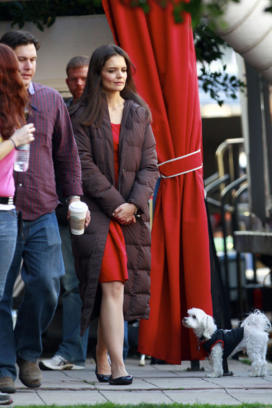 "Katie Holmes leaves the set of ""Jack & Jill"" in a red dress and puffy jacket."