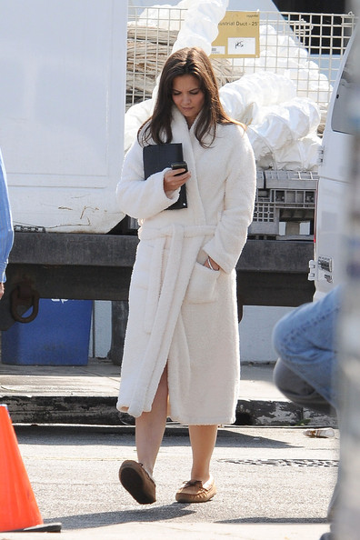 "Katie Holmes keeps her head down and focused on her cell phone as she walks on the set of her upcoming film ""Jack and Jill"". Wearing a white robe and moccasins, is currently filming her upcoming comedy opposite Adam Sandler while her husband Tom Cruise films ""Mission: Impossible IV"" in Prague."
