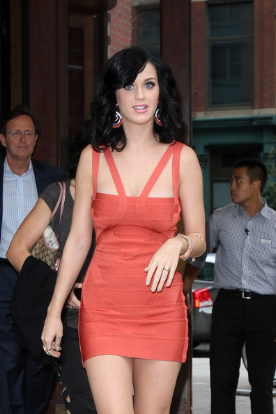 "Katy Perry Katy Perry leaving her Downtown NYC hotel wearing a skintight red dress as she heads to CBS' ""Late Show with David Letterman."