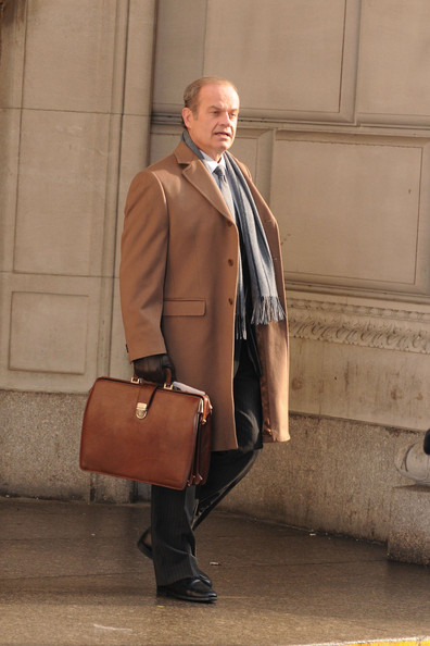 "Kelsey Grammer holds onto a brown, leather briefcase while filming a scene in lower Manhatten for his upcoming movie ""I Don't Know How She Does It""."