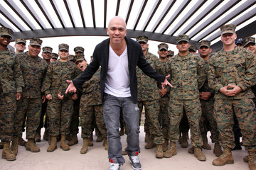 Jo Koy Khloe Kardashian and basketball star husband Lamar Odom appear on a live Fox 5 broadcast for a special pre-Thanksgiving salute to the Armed Forces