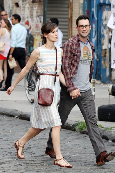 """Kiera Knightly and Adam Levine go for a casual stroll through the city as they film for """"Can a Song Save Your Life?"""" hand in hand in New York City."""