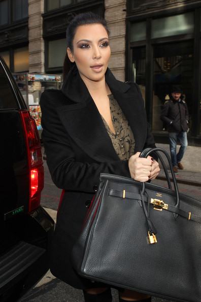 Kim Kardashian Kim Kardashian takes her sister Khloe to visit the new Dash retail store in Soho. The Kardashian sisters, who were both carrying Hermes bags, could be seen being followed around by a large group of photographers as they stopped off at an ice cream truck for a sprinkle cone.