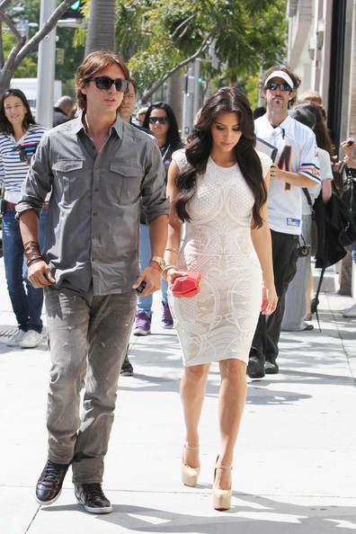 Kim Kardashian Kim Kardashian shows off her curves in a cream colored lace dress as she and PR guru Jonathan Cheban enter Nate'N Al Delicatessen in Beverly Hills.
