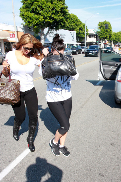 Kim Kardashian Kim Kardashian hides behind her purse as she leaves Boom Boom & Beyond salon wearing gym clothes and no makeup. Kim, who recently split with husband Kris Humphries after just 72 days of marriage, did her best to cover her face as she walked with a friend.