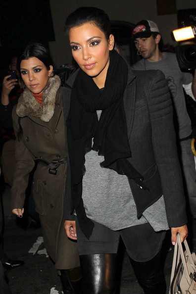 "Kim Kardashian Kim Kardashian and her sister Kourtney Kardashian continue filming their new reality show ""Kourtney and Kim Take New York"" as they head out into the city. The sisters, surrounded by a large group of fans and photographers, visited a local store in Tribeca followed by a visit to a nail salon. leaves her hotel and got into a dozens of fans and photographers. The sisters walked down the streets in Tribeca and visit a local store. Kim and Kourtney went inside of the salon but did not get their nails done."