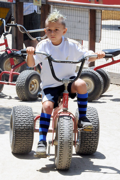 Kingston Rossdale Gwen Stefani's son Kingston rides an off-road tricycle around Underwood Farms during a family day out. Stefani took her kids Kingston and Zuma out for a fun filled day of walking the farms, eating produce, and Zuma getting a horse ride.