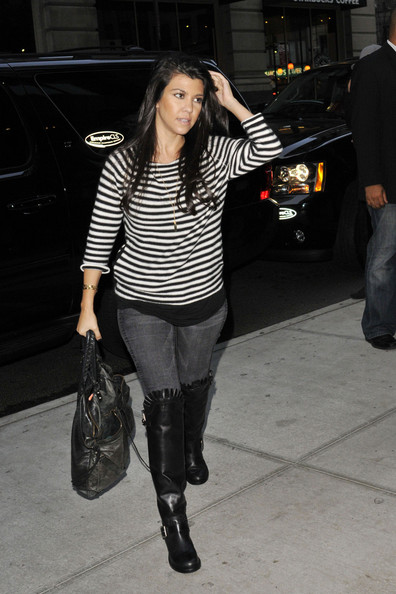 Kourtney Kardashian September 22 2011.  The Kardashian sisters, Khloe, Kim and Kourtney, are seen with Scott Disick outside of an apartment in NYC.  The happy family is greeting by photographers before entering the building.