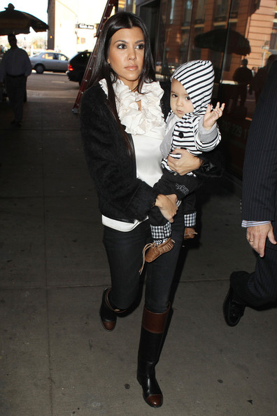 Kourtney Kardashian Kourtney Kardashian takes her son Mason, dressed in a striped hoody and leather moccasins, out apartment hunting in the Lower West Side of New York City.