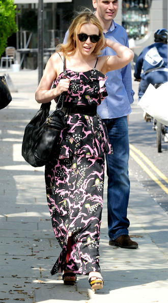Monday April11 2011. Kylie Minogue marches out of her London home in a multi-print maxie. The diminutive Antipodean is currently performing in her Aphrodite: Les Folies world tour.