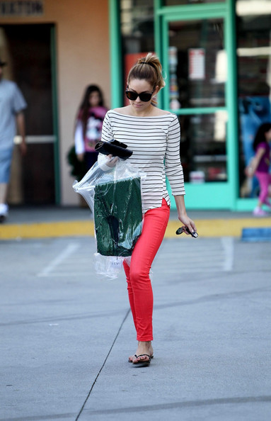 Lauren Conrad - Lauren Conrad collects her dry cleaning in West Hollywood, wearing striking red pants and a striped top