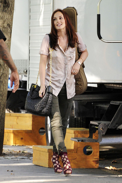 "Leighton Meester Leighton Meester on the set of ""Gossip Girl"" in NYC, leaving her trailer with her black handbag and guitar case."