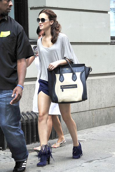 "Leighton Meester Leighton Meester arriving on the set of ""Gossip Girl"" in New York City. The young fashionista co-ordinated some purple silk shorts with some purple high-heeled mocassin boots and carried an oversized Prada purse as she made her way to work ."