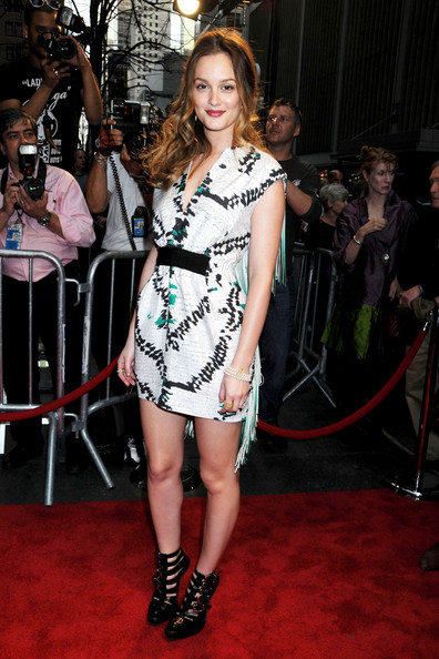 "Leighton Meester Tuesday April6 2010. Leighton Meester wears a Giambattista Valli Spring 2010 print dress with green fringe detailing on the back and black strappy Phi shoes to the New York premiere of ""Date Night"" at the Ziegfeld Theatre."