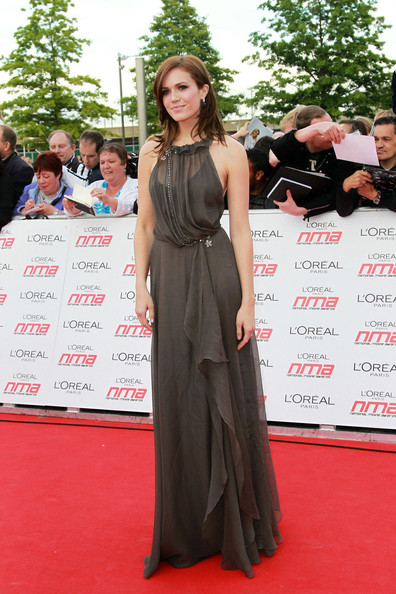 on the red carpet at the National Movie Awards held at Wembley Arena in London.