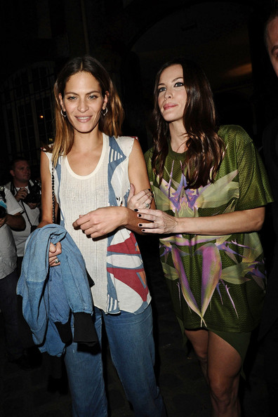 Liv Tyler Liv Tyler wears a green dress bursting with color at the Givenchy Fashion Show during Paris Fashion Week.