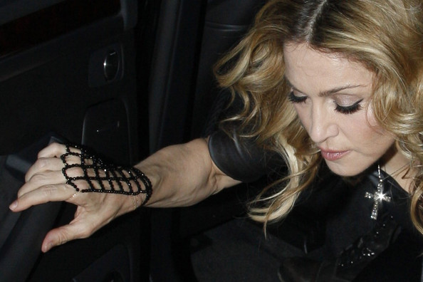 Madonna - FILE PHOTO: MADONNA'S LATEST GLOVE AFFAIR The real reason Madonna always wears gloves, to hide those ageing hands!!