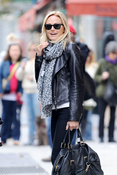 "Malin Akerman wears a Yarnz animal print scarf, leather jacket and motorcycle boots while hanging out on the set of the upcoming film ""Wanderlust"". It is rumored that Akerman's co-star Jennifer Aniston will be going topless in the new film and when E! Online asked Akerman responded, ""I'm not going to botch that rumor...There's a very big maybe, yes..."