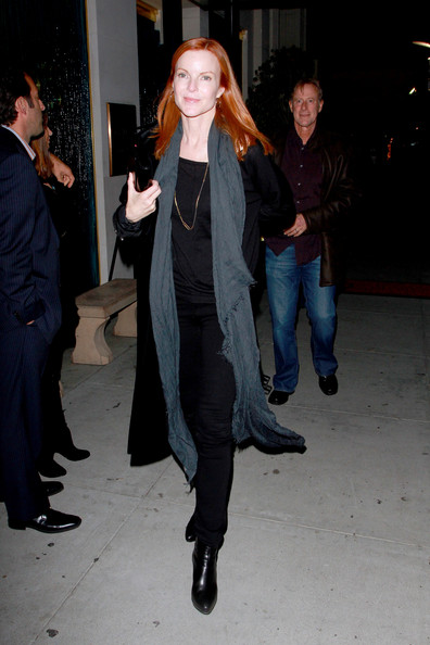 Marcia Cross Marica Cross and husband Tom Mahoney (brown leather jacket) have dinner with friends at Maestros Steakhouse. Tom was looking happy and healthy following treatment for cancer 2 years ago.