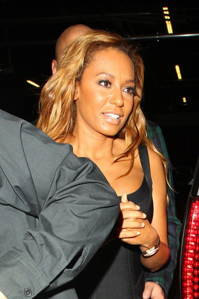 Melanie Brown A smiling Mel B exits the Cleo restaurant in Beverly Hills in a spicey skin-tight bandage dress.