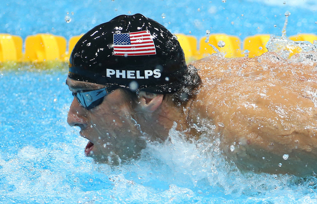 Michael Phelps wins the gold medal in the 100m butterfly ...