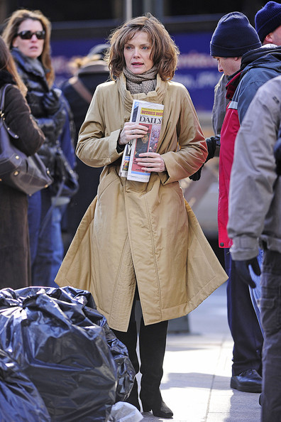 "Michelle Pfeiffer holds onto a copy of the New York Daily News while filming a scene for the upcoming comedy ""New Year's Eve"". In the scene, Pfeiffer tries to cross a busy NY street put is pushed back into a pile of trash as a taxi speeds by. Michelle is rumored to be cast opposite Johnny Depp in Tim Burton's upcoming project ""Dark Shadows""."