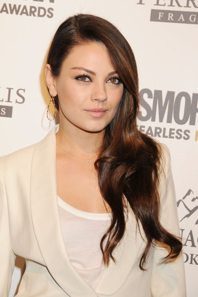Mila Kunis poses for photographs at Cosmopolitan Magazine's Fun Fearless Males of 2011 event held at the Mandarin Oriental hotel in New York City.