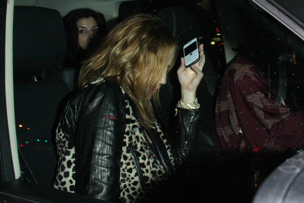 Miley Cyrus A camera-shy Miley Cyrus arrives at over 21s club, Voyeur, in West Hollywood.