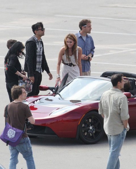 Miley Cyrus Photoshoot In A Tesla Roadster