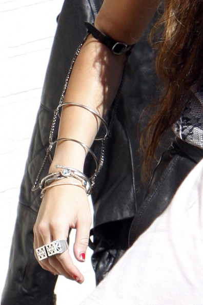 "Miley Cyrus Miley Cyrus's edgy jewellery as she leaves London's Fountain Studios. The 17-year-old had been rehearsing for a live performance of her new single ""Can't Be Tamed"" for the popular TV show ""Britain's Got Talent""."