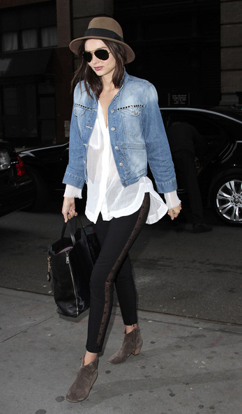 Miranda Kerr Miranda Kerr wears an embellished denim jacket, sheer top and fedora while arriving at a New York City Medical building.