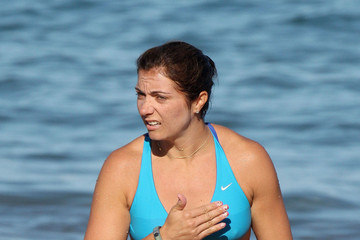 Misty May-Treanor Olympic volleyball player Misty May-Treanor goes for a swim with husband Matt Treanor before going paddleboarding with a friend in Hawaii