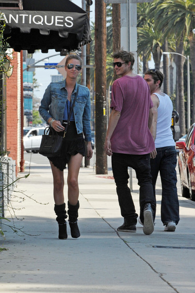 Nicky Hilton gets the attention of a male passer-by as she walks down the street in Beverly Hills. The man seemed unable to take his eyes off Nicky, seen walking in a short skirt and boots.