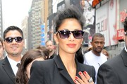 "Actress Nicole Scherzinger makes an appearance in New York City at the NASDAQ building where she posed with a slew of black suit wearing ""agents"" as she promoted ""Men In Black 3""."