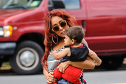 Nicole Polizzi carries her son Lorenzo to a DNA testing clinic in Northern New Jersey on August 7, 2013.