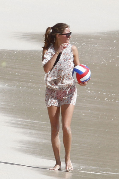 Olivia Palermo and boyfriend Johannes Huebl spend another day in the sun while on holiday together in St. Barts. Palermo, wearing a red bikini, played soccer and paddle ball on Saline Beach with her boyfriend Johannes. The couple then cooled off with a dip in the ocean where they were seen getting a close. Saline Beach is a popular destination in St. Barts for nudists, however both Olivia and Johannes stayed clothed.