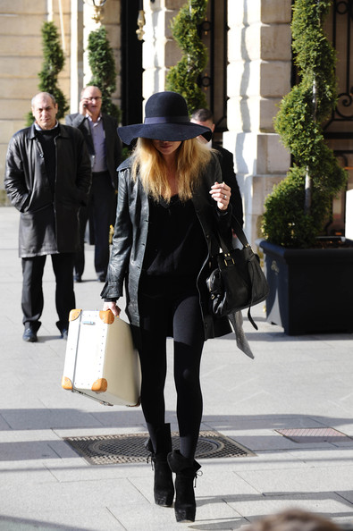 Kate Moss leaves the Ritz Hotel in Paris with luggage in hand. The supermodel has been enjoying Fashion Week in in the French capital.
