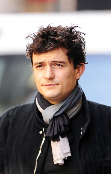 Orlando Bloom Orlando Bloom sports a messy head of hair as he heads to a New York City gym for a morning workout. Bloom and wife Miranda Kerr were spotted the previous day pushing their son Flynn in a stroller around NYC.